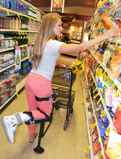 knee scooter in walking boot with broken metatarsal shopping